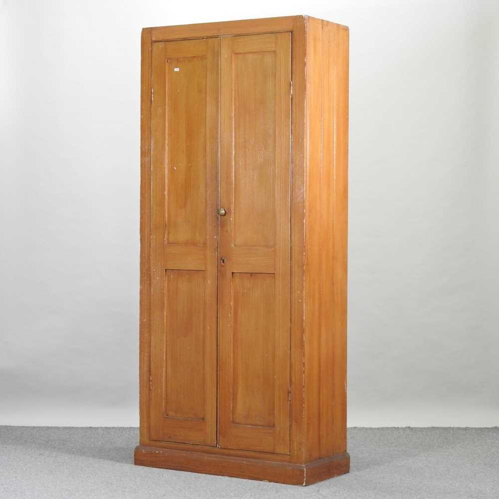 An early 20th century grained pine school cabinet
