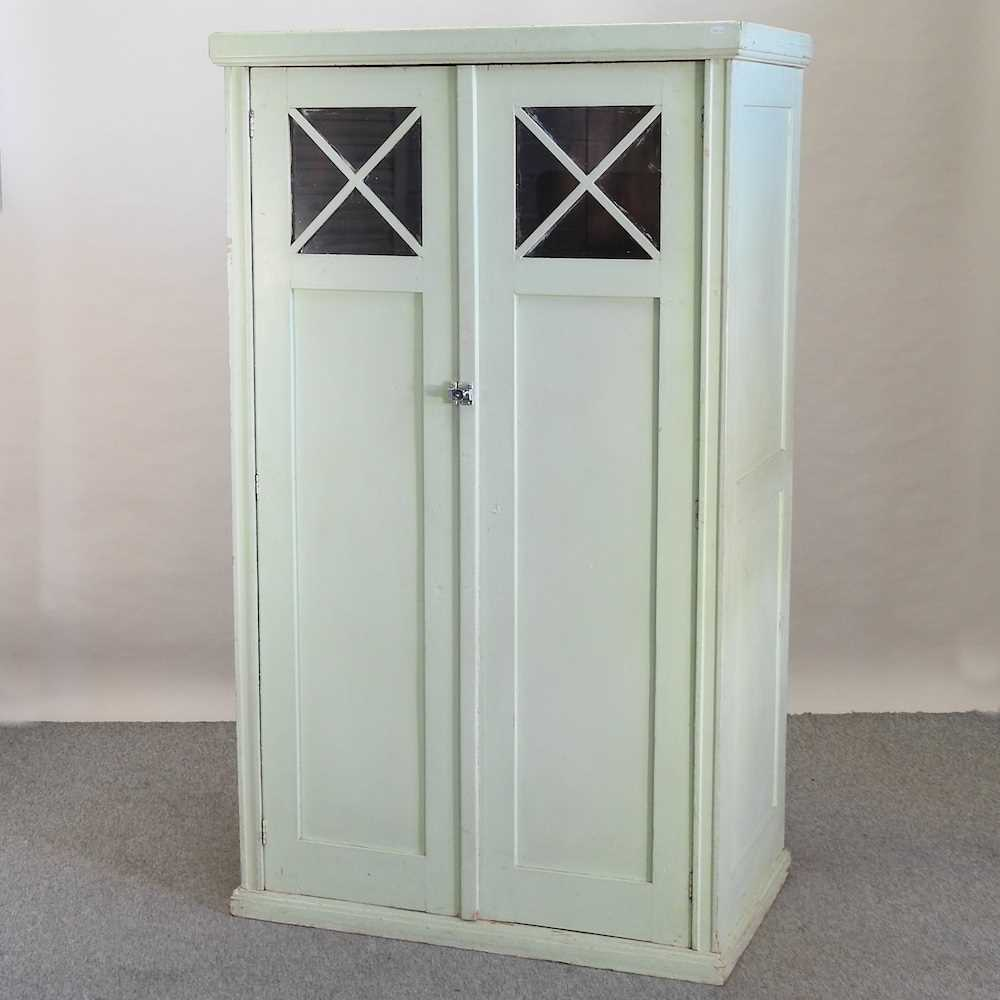An early 20th century green painted French armoire