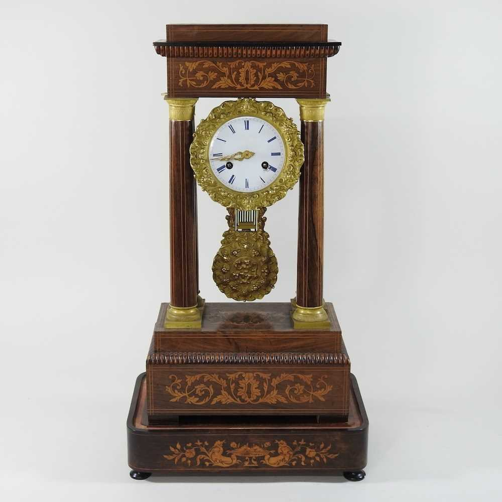 A Napoleon III rosewood and marquetry portico clock