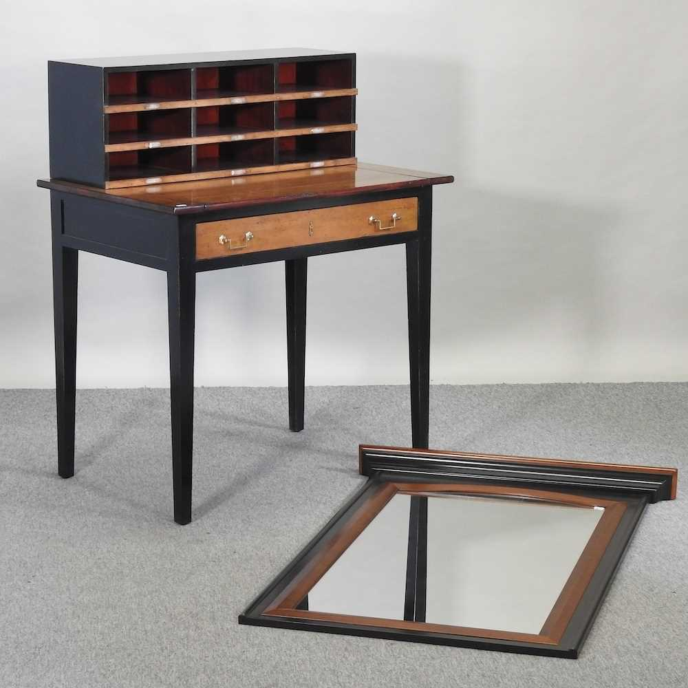 A reproduction French style fruit wood and black painted desk