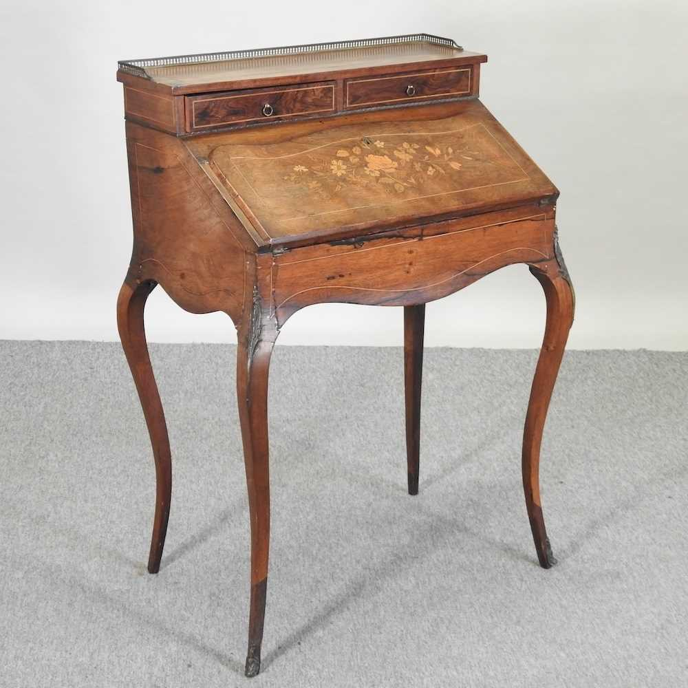 A late 19th century French style marquetry bureau de dame