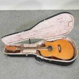 A Fender Montana electro acoustic guitar