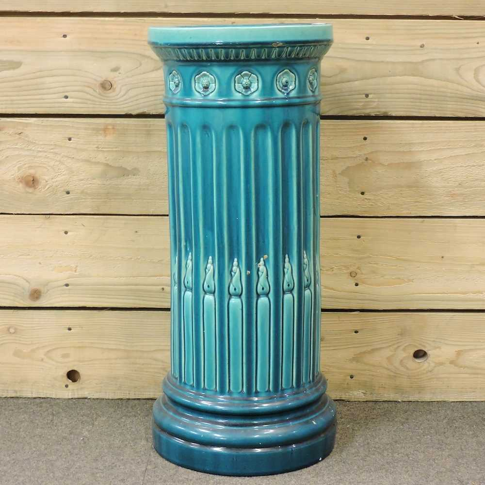 An early 20th century Bretby blue glazed jardinière base