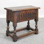 A Victorian carved oak stool