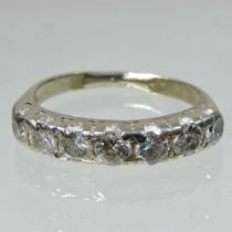An unmarked diamond half hoop eternity ring