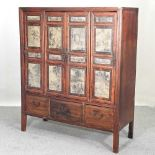 A 20th century Chinese hardwood cabinet