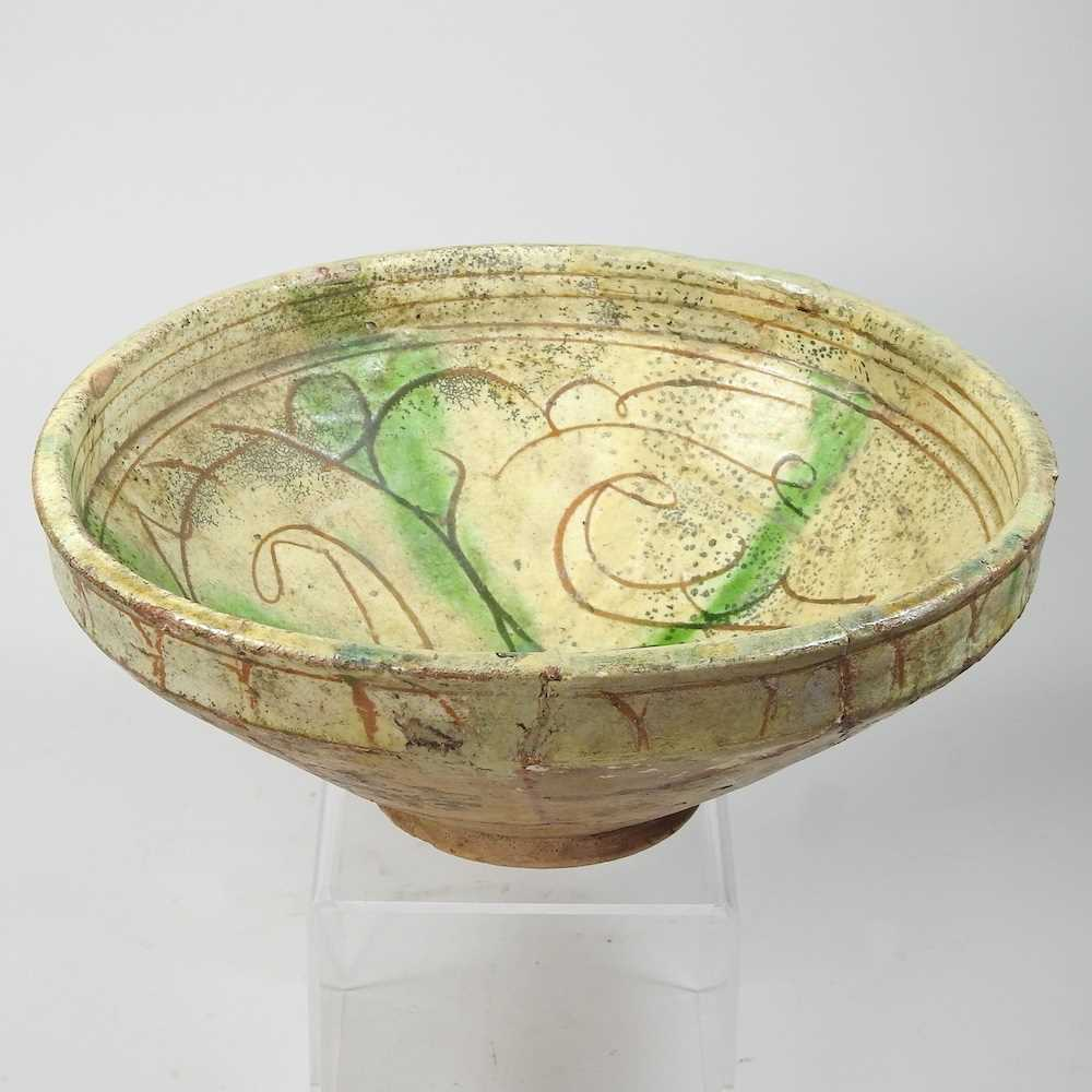 A Persian glazed pottery bowl