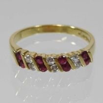 An 18 carat gold, ruby and diamond half-hoop eternity ring