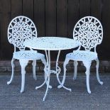 A white painted metal patio set