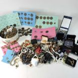 A collection of costume jewellery and coins