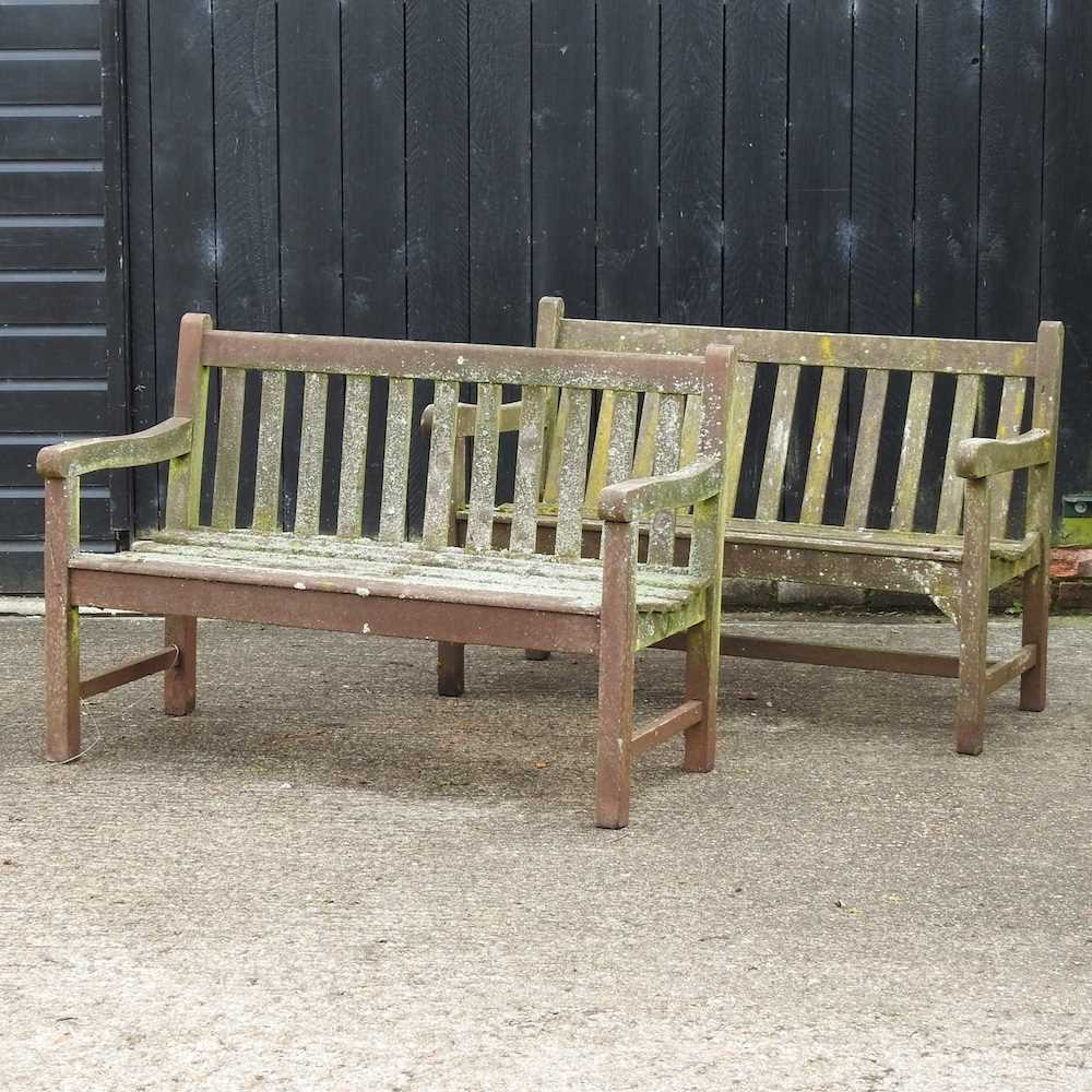 A teak slatted garden bench