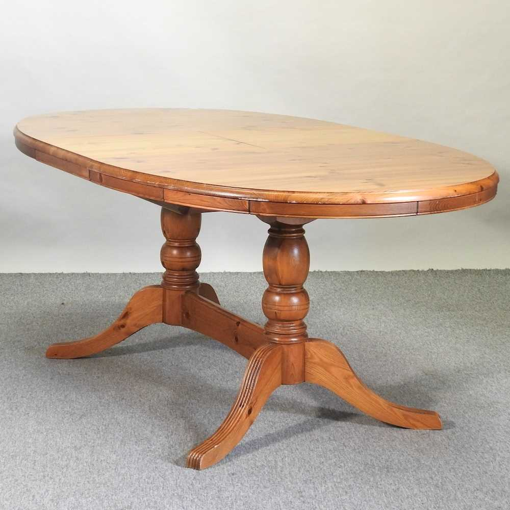 A pine oval dining table