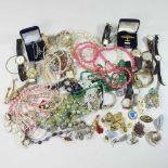 A collection of costume jewellery and watches