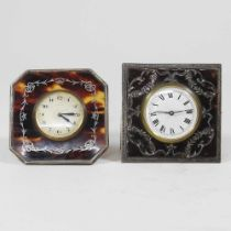 An early 20th century silver and tortoiseshell strut clock