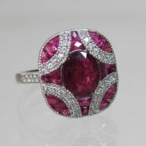 A platinum. ruby and diamond cluster ring