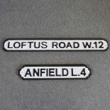 A modern wooden road sign of Anfield