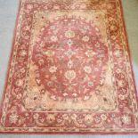 A Persian woollen carpet