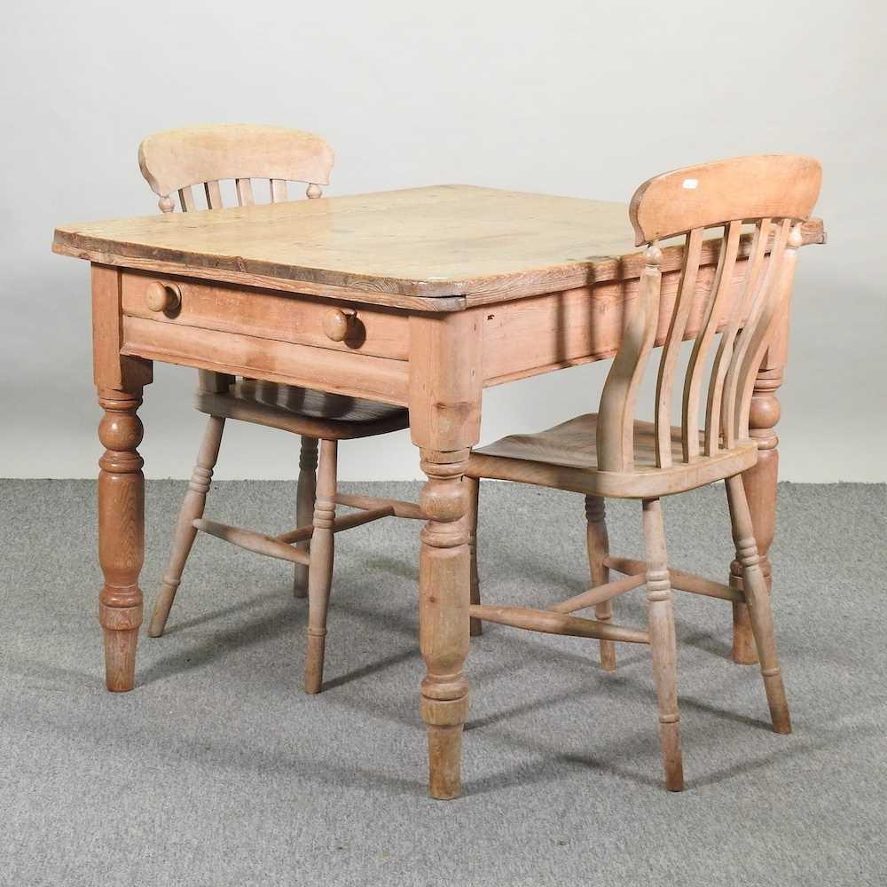 An antique pine kitchen table