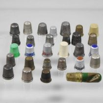 A collection of silver thimbles