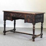 A 19th century carved oak kneehole desk