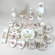 A set of five Dresden floral painted coffee cups and saucers