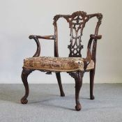 A George III Chippendale style mahogany elbow chair