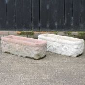 A pair of reconstituted stone troughs