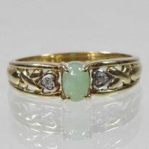 A 9 carat gold diamond and jade ring