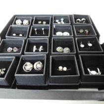 A collection of pairs of earrings