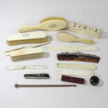 A collection of early 20th century dressing table items