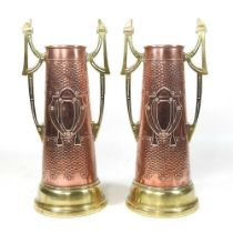 A pair of Arts and Crafts brass and copper vases