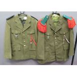 Two French Foreign Legion Tunics consisting khaki, single breasted, open collar tunic. Pleated