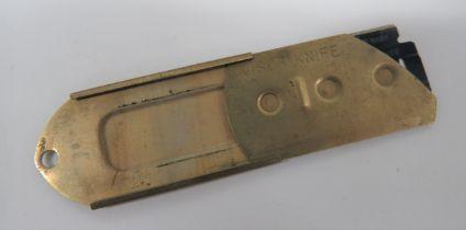 "WW2 Escape and Evasion ""Visor Knife"" rear brass cover with front slide marked ""Visor Knife""."