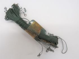 RAF Escape and Evasion Fishing Kit consisting green coloured fishing line, wire line/hook