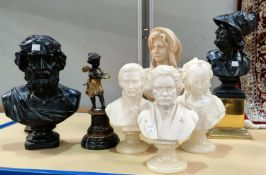 A variety of resin busts on stands in the classical manner, largest 38cm, smallest 23cm