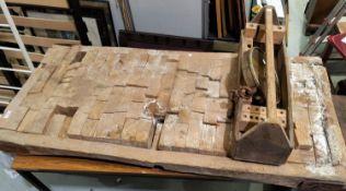 A butcher's large spring balance by Salter; a carpenter's toolbox; A rectangular segmented top
