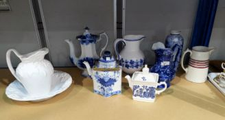 A collection of blue & white jugs, etc., 19th century and later