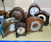 Six 1930's mantel clocks in oak and stained wood cases