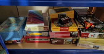 A large selection of modern jigsaws (not guaranteed complete)