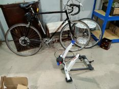 """An """"Alpha Sport"""" racing bicycle with Tacx stand"""
