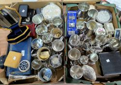 A large selection of unused pewter tankards; other pewter and silver plate