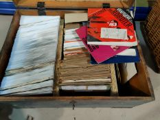 A large collection of mid/late 20th century single records contained in a wooden box