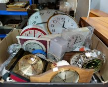 A large wall clock; other wall, alarm and mantel clocks; etc.