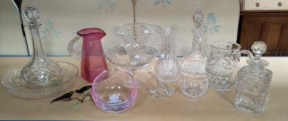 A selection of various decanters and cut and other glassware