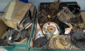 A selection of old clock parts; movements; springs; etc.
