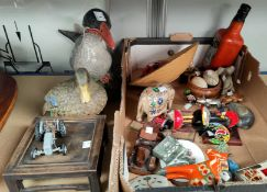 A collection of animal figures and decorative figures