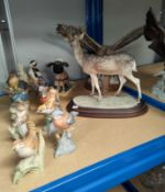A resin deer and eagle; a selection of bisque animals and birds