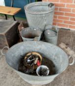 A metal dolly tub and vintage garden equipment