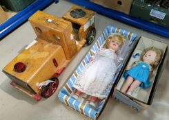 A ride-along toy engine and two 1960's dolls