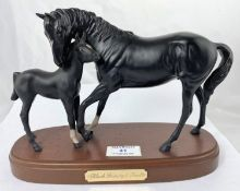 A Royal Doulton ceramic group Black Beauty and foal on wooden base